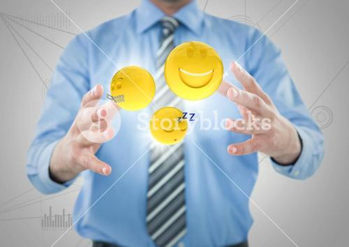 Business man mid section with flares and emojis between hands against white network
