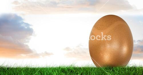 Easter Egg in front of cloudy sky