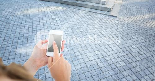 woman hands with the phone in the street