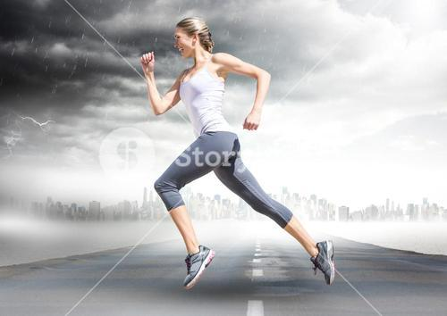 Female runner going across road with skyline and storm