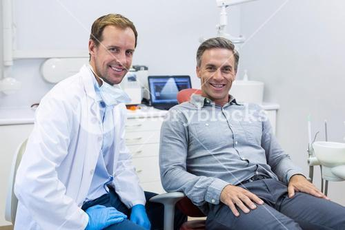 Portrait of smiling dentist and patient