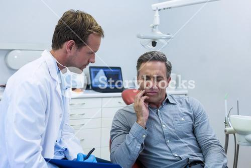 Dentist examining a male patient