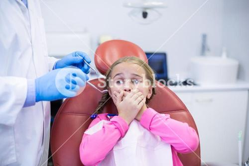 Young patient scared during a dental check-up