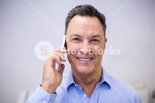 Dentist talking on mobile phone