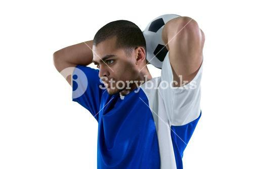 Football player about to throw the football