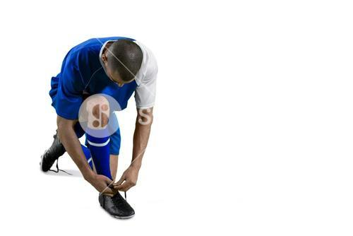 Football player tying his shoe lace