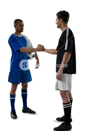 Two football players shaking hands