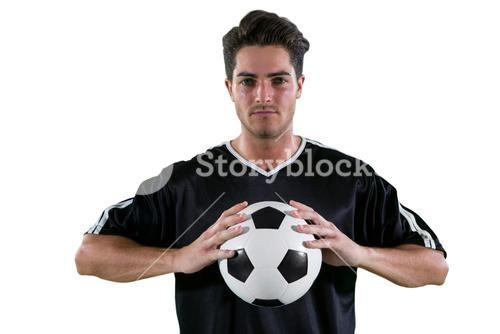 Football players holding football with both hands