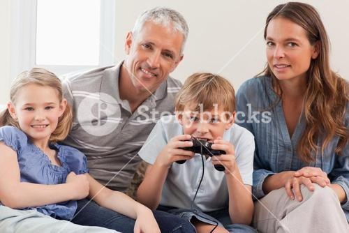 Charming family playing video games