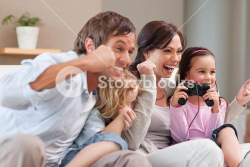 Positive family playing video games together