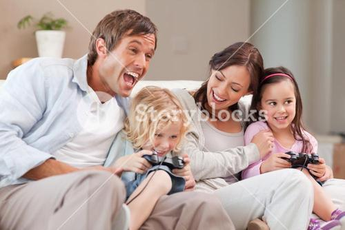 Laughing family playing video games