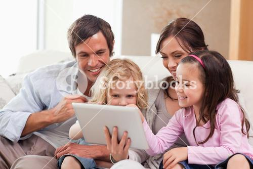Delighted family using a tablet computer
