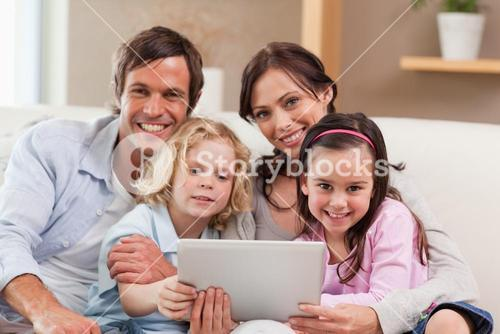 Charming family using a tablet computer