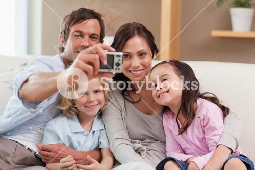 Father taking a picture of his family