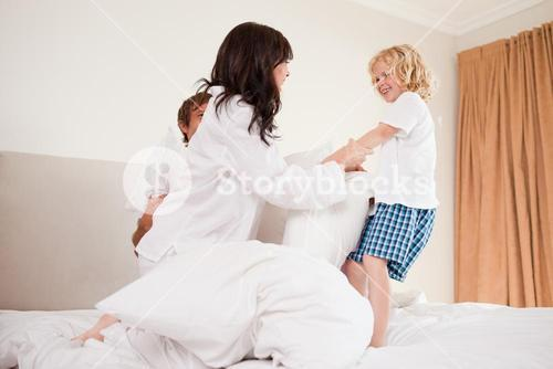 Playful family having pillow fight
