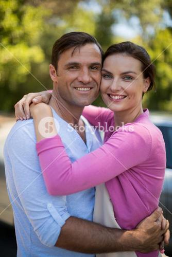 Portrait of smiling couple embracing