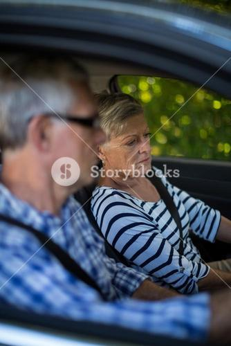 Senior woman and man in car