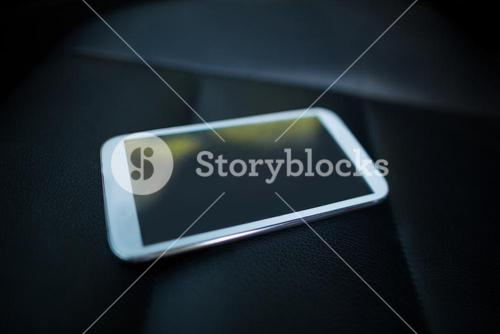 Mobile phone on car seat