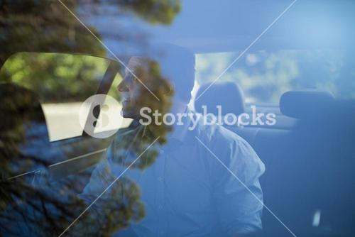 Man sitting on back seat  in car