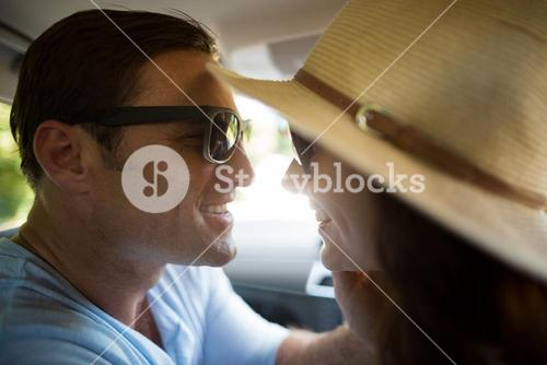 Romantic couple traveling in car