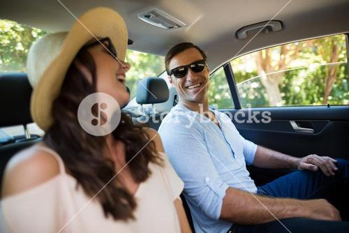 Couple traveling in car