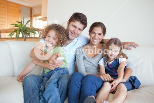 Happy family watching TV together