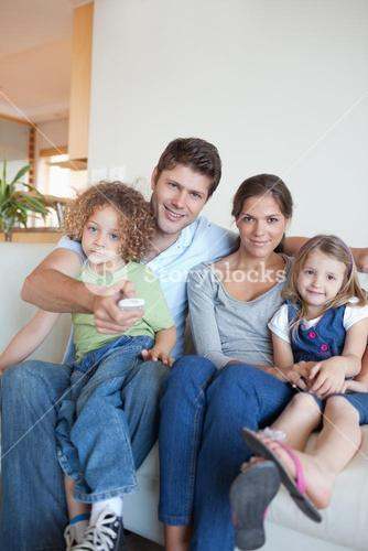 Portrait of a family watching TV together