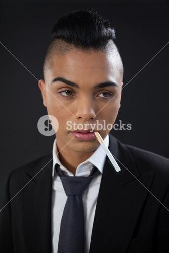 Transgender with cigarette in mouth