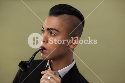 Close up of transgender woman with smoke pipe