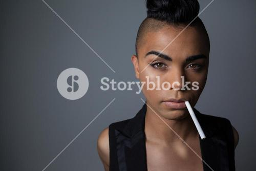 Portrait of transgender woman with cigarette in mouth