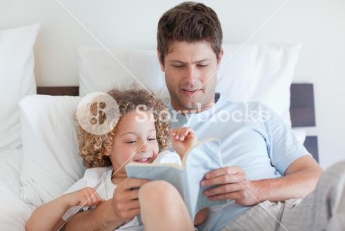 Father reading a story for child
