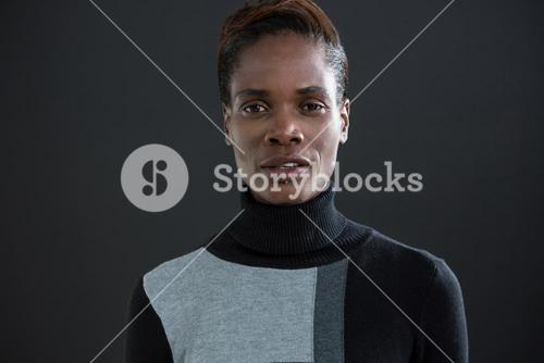 Androgynous man against grey background