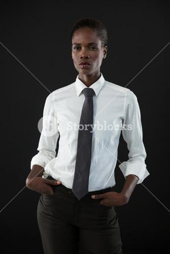 Androgynous man standing with his hands in pocket