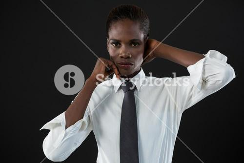 Androgynous man posing against grey background