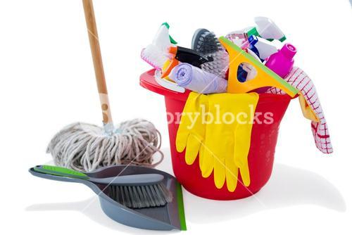 Mop and dustpan by cleaning products in bucket