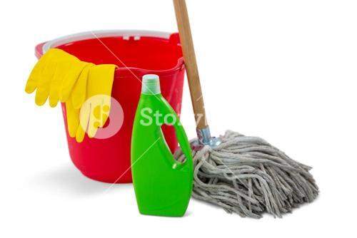 Close up of chemical bottle and mop with bucket