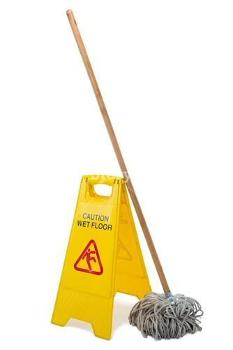 Yellow sign board with mop