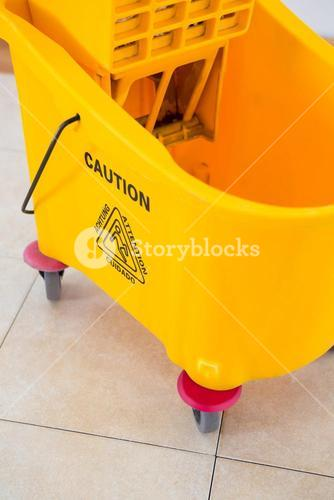 Close up of yellow mop bucket