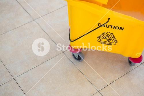 High angle view of sign on mop bucket