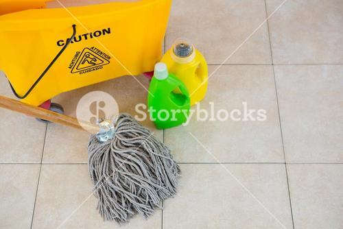 High angle view of bottles by mop bucket