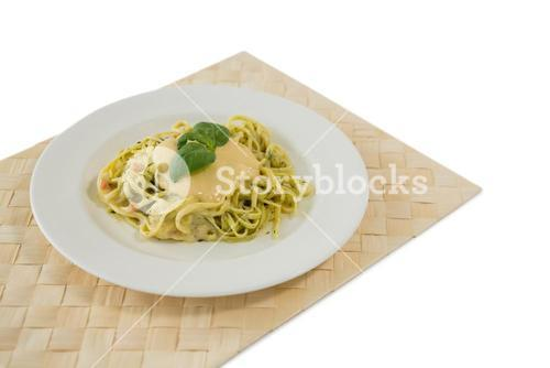 Close up of fettuccine served in plate on place mat