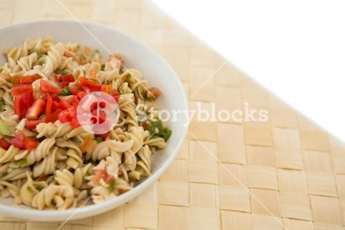 Close up of rotini served in bowl on place mat