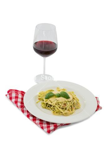 Pasta served in dish by wineglass