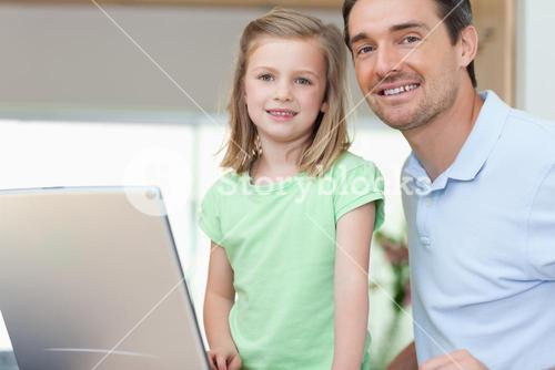 Father and daughter together with laptop