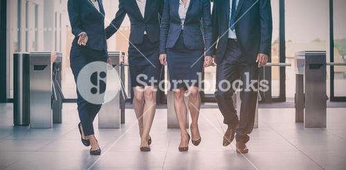 Businesspeople walking in office