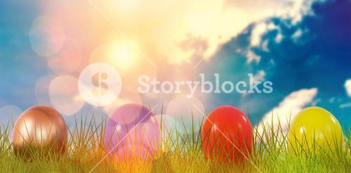 Composite image of mulit colored shiny easter eggs on grass