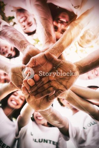 Group of environmentalists stacking hands