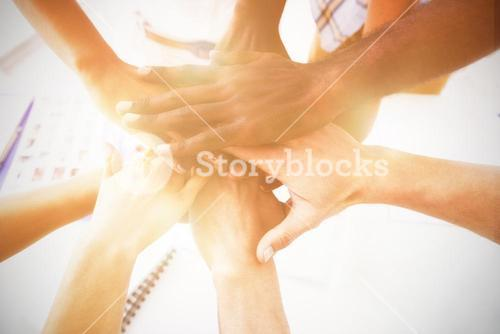 Cropped image of business colleagues stacking hands
