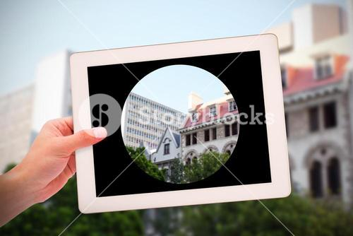 Composite image of masculine hand holding tablet