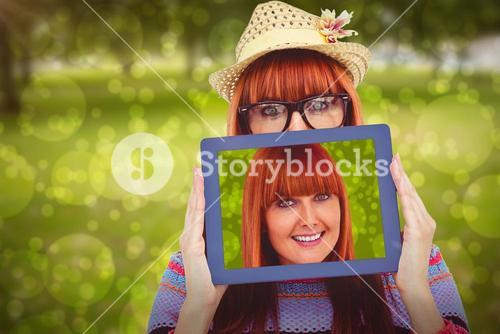 Composite image of attractive hipster woman behind a tablet